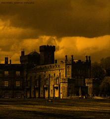 STORM THE CASTLE (michaeljohnsimages) Tags: camera old ireland light shadow wild sky cloud storm black building tower castle art yellow wall clouds canon dark landscape gold flickr view bright photos entrance explore journey land grounds discover