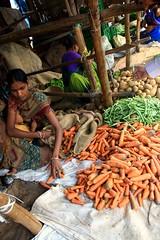 (anambakali08) Tags: food woman india vegetables beans child market carrots breastfeeding