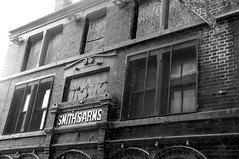 Smith's Arms (Peter Rea 13) Tags: white house black public up manchester fire mono pub arms burnt shutters smiths boarded ancoats