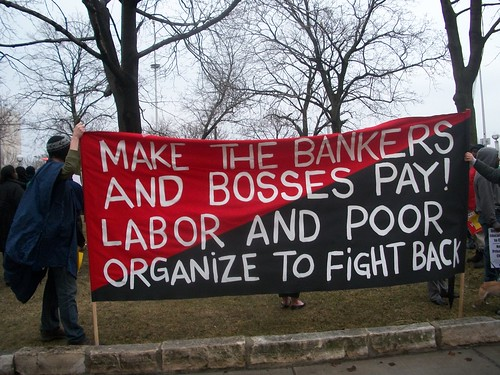 A banner put together by youth saying that the bankers and bosses should pay for the economic crisis and not the workers. The banner was carried in a march of several thousand on April 4, 2011. (Photo: Abayomi Azikiwe) by Pan-African News Wire File Photos