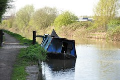 Burnt Narrowboat (Nik Sibley) Tags: water boat canal burnt coventry narrowboat arson waterway towpath hawkesbury coventrycanal hawkesburyjunction suttonstop