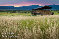 Evening Sky on Montana Farm (jim_david) Tags: sunset mountains grass barn rural landscape town montana glow country hay shelter bale helmville hayshelter