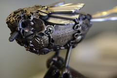 """Terminator XII - Rise of The Birds"" (Just George 2) Tags: sculpture bird screw iso3200 dof head welding humor slot gs flatware whimsey nutsandbolts philipshead cotterpin canoneos5dmarkii militarybutton canonef100mmf28lmacroisusm"