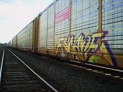 ______________ESCAPE_ (SkinnyKidN/W4) Tags: railroad blue red green colors up yellow oregon burlington yard train bench portland photography gold graffiti paint neon nw escape shot pacific northwest bright union perspective rr canadian fresh line clean crisp pdx fe dope cp northern freight bnsf 503 sante autorack autoracks autoraxx nasty93cc
