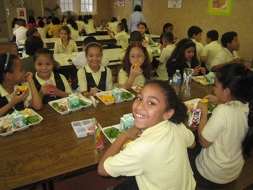 Schoolchildren at Bruce-Monroe Elementary School in Washington, D.C. celebrate lunch after receiving their Gold Award of Distinction honor through USDA's HealthierUS School Challenge.