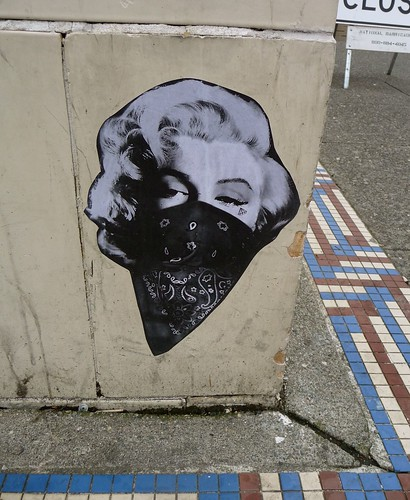 pasted graffiti -- Marilyn Monroe wearing a bandana over her face