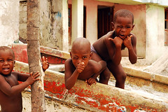COL-tierrabomba-0706-244-v1 (anthonyasael) Tags: 3 african ethnicity africans america bald baldness bend bending black boy boys cartagena child children only closeup colombia companion elementary age enjoy enjoying enjoyment excite excited excitement friend friends friendship front view fun happiness happy horizontal innocence joy joyful kid kids latin leisure activity little mischief mischievous people person play playful portrait portraiture semidress small south spare time stand standing three tierrabomba together waist up wall wink winking