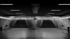 Subway Station Rathaus Süd (mkniebes) Tags: urban blackandwhite station sign metal architecture stairs zeiss geometry tube symmetrical bochum 2014 distagont235 zf2