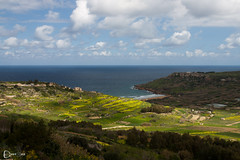 Light cuts Ramla Bay in Half (edward.duca) Tags: sea beach nature canon landscape bay coast hills gozo ramla ramlailhamra