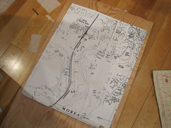 enlarged map sitting on a slab of wood