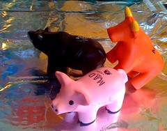 Looking a bit bullish... (chicbee04) Tags: news reading bears bulls figurines headlines pigs and outloud bearish thestreet jimcramer piggish madmoney bullish