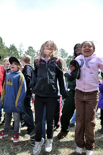 Students from Rockrimmon Elementry School dance with Forest Supervisor during Kids4Trees event on Pike National Forest