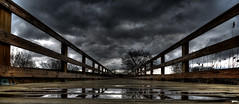 Bridge of sighs (Rjacobsen) Tags: wood bridge lake reflection clouds forest landscape nikon moody view angle low wide scenic mallard storms preserve d300 scenicsnotjustlandscapes