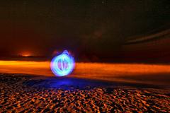 Beach Orb (Matt Molloy) Tags: ocean longexposure blue red sky lightpainting reflection beach me water night ball myself circle stars sand waves cuba footprints orb led spooky sphere cycle spinning poi glowsticks mattmolloy