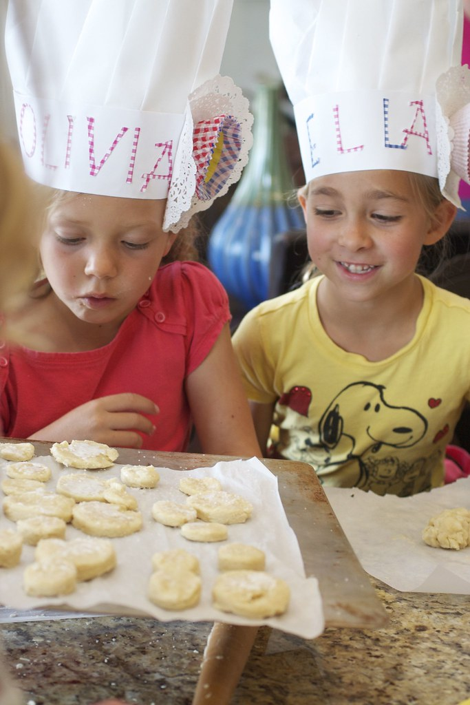 olivia and ella checking out the shortcakes