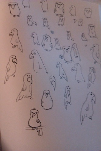 a page full of line drawings of parrots