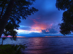 west lake view (paul bica) Tags: park pink blue trees sunset sky sun lake tree beach nature water clouds reflections relax paul outdoors evening photo soft waves quiet view image wind weekend pastel belleville peaceful imagine imagination lakeontario leafs sandbanks dex provincial hallowell princeedward islandrd paulbica 20110625belleville720