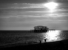 West Pier Brighton in the Evening (twinbowlers) Tags: blackandwhite brighton sky sea sun canonpowershotg12