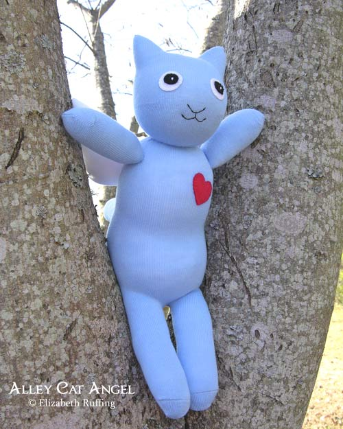 Alley Cat Angel Hug Me Sock Kitten by Elizabeth Ruffing, blue with red heart, in a tree