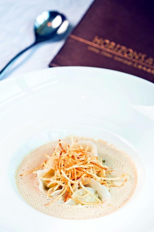 Mushroom veloute with foie gras ravioli, truffle oil