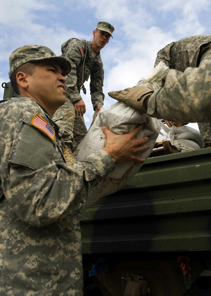 Indiana National Guard members perform sandbagging operations in support of flood repsonse