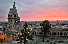 Sunrise over Budapest (lyellc) Tags: city morning sky orange building tower castle history stone wall architecture fairytale sunrise river landscape boat europe hungary fishermen cathedral budapest landmark s courtyard palace historic magyar bastion magical danube hdr buda pest attraction pinnacle rampart photoengine worldhdr