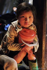 The Eyes (LeonardKong) Tags: life lighting portrait people baby love cooking kitchen face kids fire photography eyes asia village image traditional flash picture vietnam kong eggs hanoi leonard  sapa gettyimages                  wwwleonardkongcom
