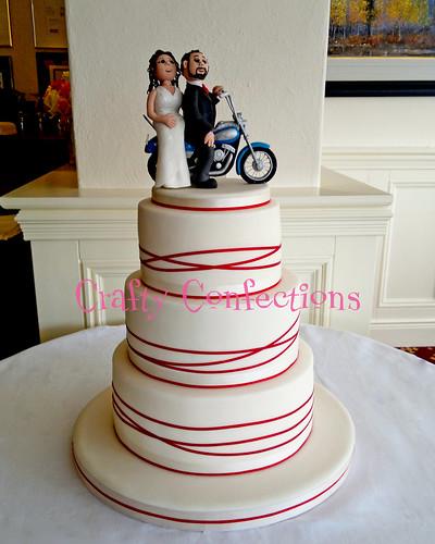 Ribbon wrap wedding cake with B&G topper
