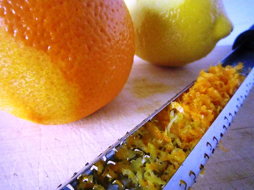 Zesting a lemon and orange, take one