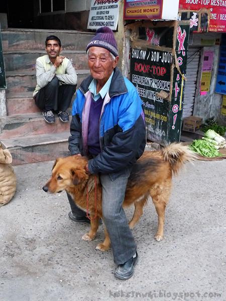 Tibetan Man Riding Dog