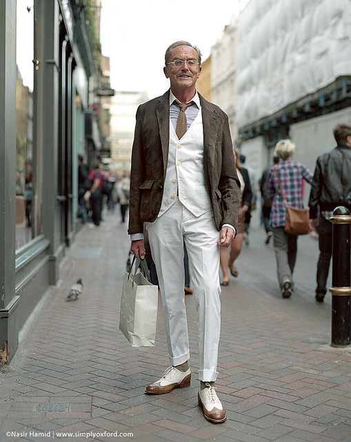 A smartly dressed man on a London street