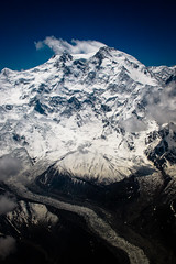 Nanga Parbat and Raikot Glacier (Lil [Kristen Elsby]) Tags: pakistan mountain snow mountains ice clouds landscape flying inflight asia topv1111 flight aerial glacier alpine pia himalayas southasia himalayanrange nangaparbat airsafari fairymeadows nakedmountain raikotglacier gilgitbaltistan canong12 gettyimagesmiddleeast