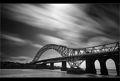 Back to the Bridge.... (Chrisconphoto) Tags: longexposure bridge blackandwhite bw clouds landscape movement filter runcorn merseyside weldingglass