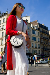 Street - What time is it, please ? (Franois Escriva) Tags: street streetphotography candid people olympus omd sky blue sun light summer clouds colors red white black buildings sunglasses time watch clock woman girl beautiful pretty cute