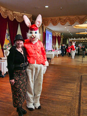 """Beautiful Sally Poses with the Giant """"Year of the Rabbit,"""" Rabbit (Walker Dukes) Tags: california wood pink blue red woman photoshop canon big floor infinity silk ears jacket mature cap curtains lovely satin topaz topazadjust canons95"""