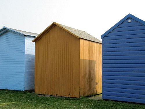 Three beach huts at Hamworthy