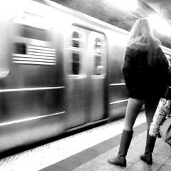 DAY 631: FAST FLAG SUBWAY B&W (bill sweeney4) Tags: city nyc newyork blur reflection girl station speed train underground subway movement streak metro platform motionblur transportation transit commute figure mta stillness lightanddark stillfiguremovigtrain stillfigure