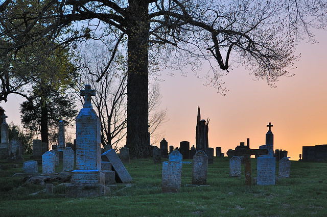 Saint Vincent de Paul Roman Catholic Church, in Dutzow, Missouri, USA - cemetery at sunset