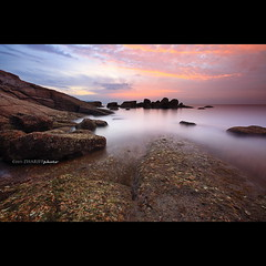 Batu Ferringhi (Zhariff) Tags: sunset beach rock landscape slowshutter penang batuferringhi
