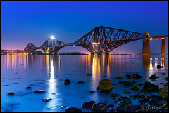 Edinburgh - Forth Railway Bridge on Firth of Forth (Yen Baet) Tags: city uk bridge reflection water architecture night marina river evening scotland pier twilight construction ancient edinburgh iron europe view riverside unitedkingdom fife britain dusk steel scenic scottish rail railway landmark icon structure scot bluehour iconic suspensionbridge firthofforth queensferry forthroadbridge forthrailwaybridge