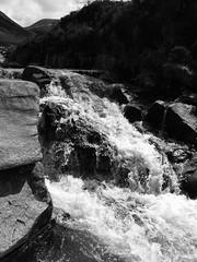 Catacol Burn by the Flat Rocks (shotlandka) Tags: blackandwhite nature water monochrome river scotland countryside rocks stream glen hills burn finepix fujifilm isleofarran   catacol     s1000fd catacolglen