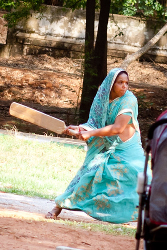 Woman playing cricket in Cubbon Park in Bangalore