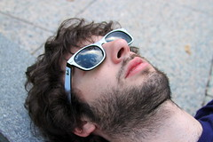 Jason in the Clouds (Riverside) (emibell) Tags: newyorkcity reflection sunglasses clouds digital chelsea riverside pavement hipster westvillage dreams indie hudsonriver hip relaxation rayban digitalphotography daydreams wayfarers digitalcolor indiekid 2011 raybansunglasses digitalcolorphotography jasonlester canoneos7d emibell
