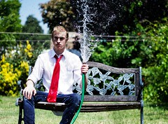 Watering formality. (David Talley) Tags: trees david water grass rain speed fence bench high formal tie hose jeans casual 365 benches talley waterhose whiteshirt redtie 365project davidtalley