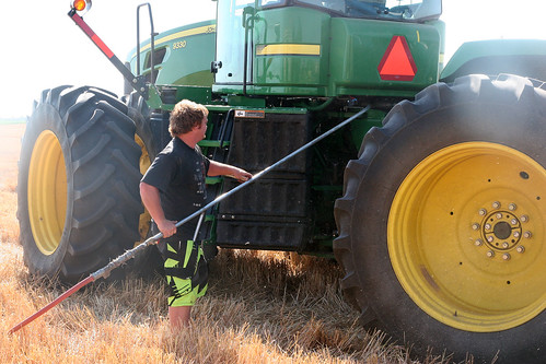 Johan blows off the tractor.