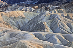 Zabriskie Point (Byron O'Neal) Tags: california sunset nationalpark desert erosion deathvalley geology 1001nights zabriskiepoint furnacecreek deathvalleynationalpark mygearandme mygearandmepremium