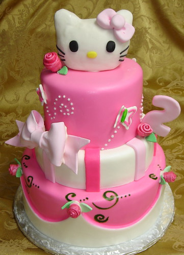 Three tier pink and white fondant custom designed hello Kitty 2nd birthday cake withe roses and bows