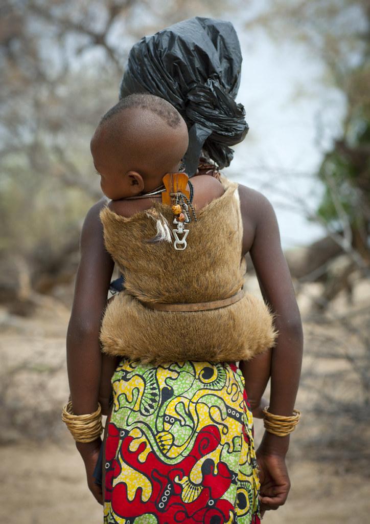 Mukubal Girl Carrying Her Brother in a Dik Dik skin,  Angola
