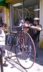 Penny Farthing wows the mechanics at Flying Pigeon LA (ubrayj02) Tags: bike la flying losangeles pigeon bicycles penny pennyfarthing ordinary farthing highwheel boneshaker flyingpigeon flyingpigeonla flyingpigeonlacom flyingpigeonlosangeles