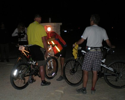 Day 2 of the W100 got started at daylight, so a few bike adjustments are made by flashlight
